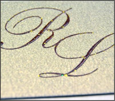 Stampa del testo, dei nomi o delle iniziali in termorilievo